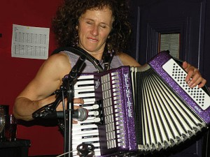 Alizon plays the accordion